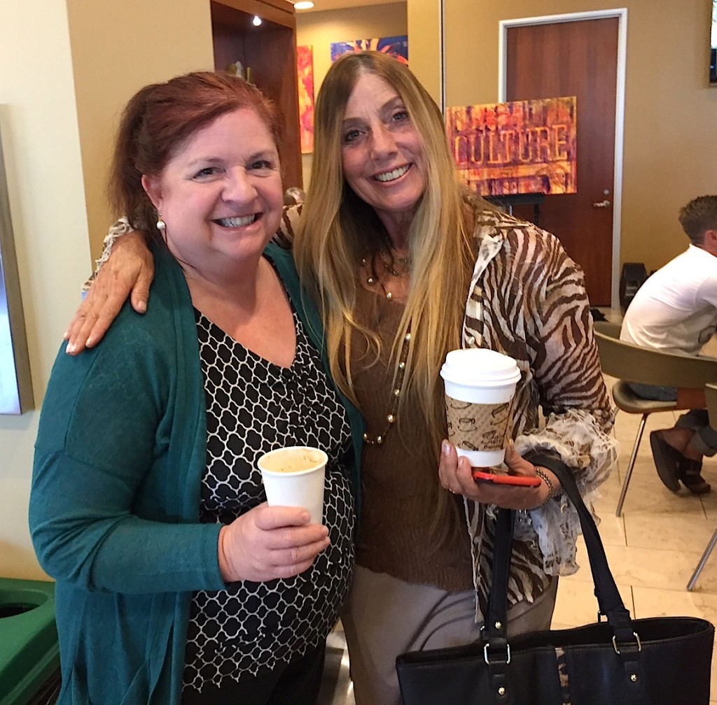Meeting of the media: Shera Sandwell, right, embraces Kathy Valentine, UT sale rep at CULTURE opening.